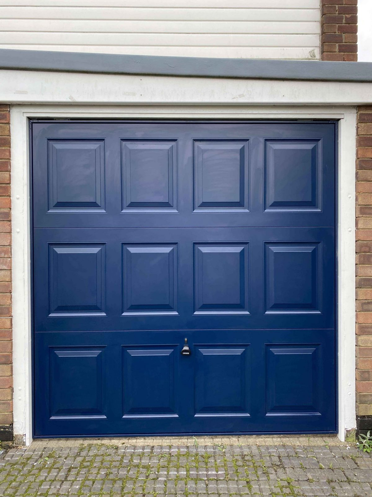 Blue up and over Georgian style garage door
