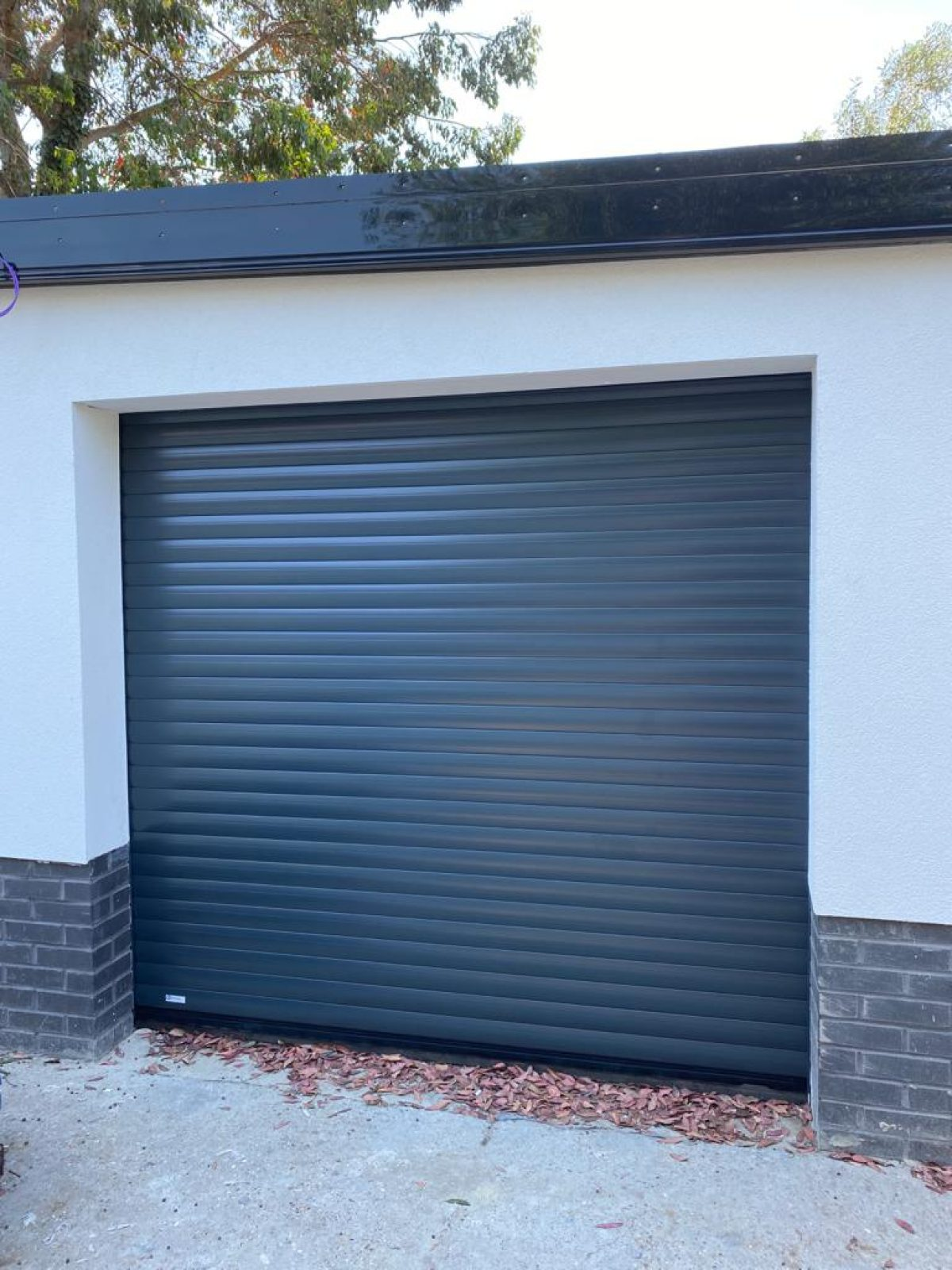 Dark grey roller garage door