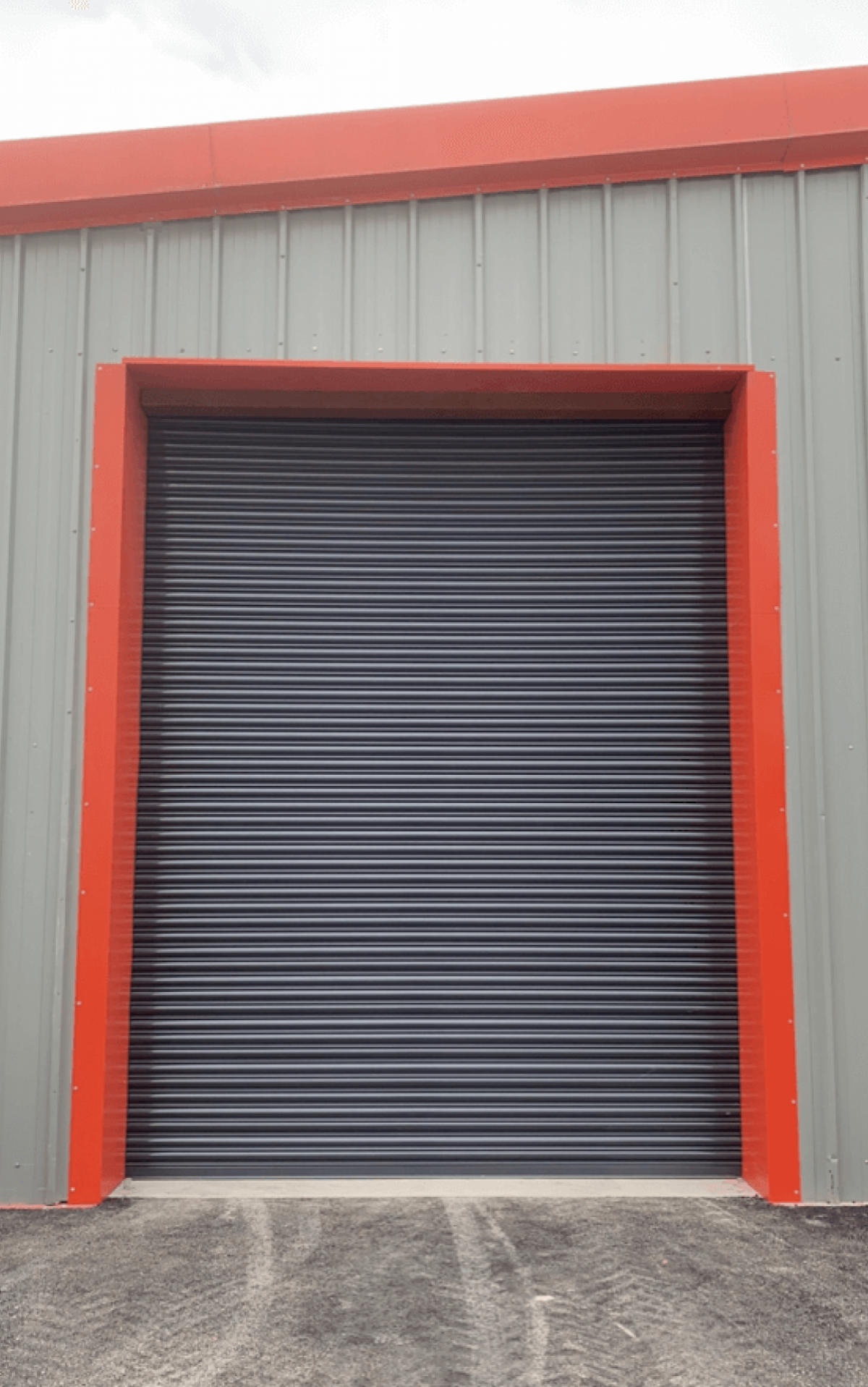 Grey door with red border on warehouse