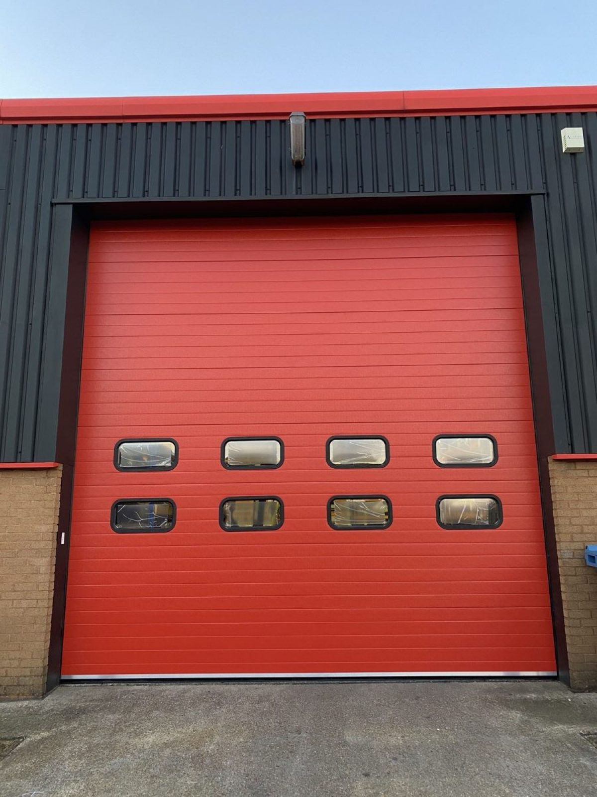 Red industrial sectional door